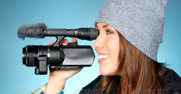 Hip Young Adult Female Points Video Camera