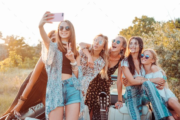 Six beautiful girls make selfie in nature in the countryside